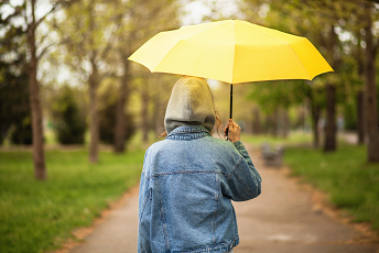 person with yellow umbrella